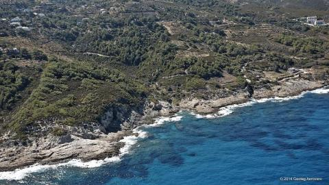 Quiet little cove surround by rocks in northern Ikaria