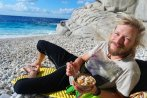 Chris having breakfast in Seychelles beach.